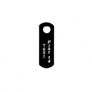 black metal tag