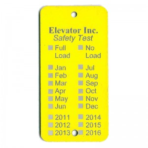 yellow elevator inspection tag