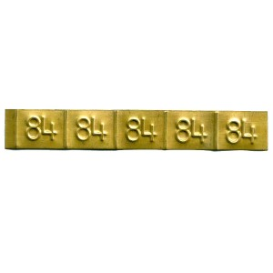 brass embossed tag